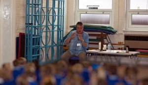 David reading poems at Over St John's Primary School