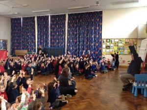 David surrendering to pupils at Pheonix Infant School! Really it's a poem about creepy crawlies!