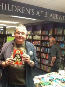 I seem to have my eyes closed here, most odd. That's Ron just behind me looking at books on the shelf of the bookshop. As you do.
